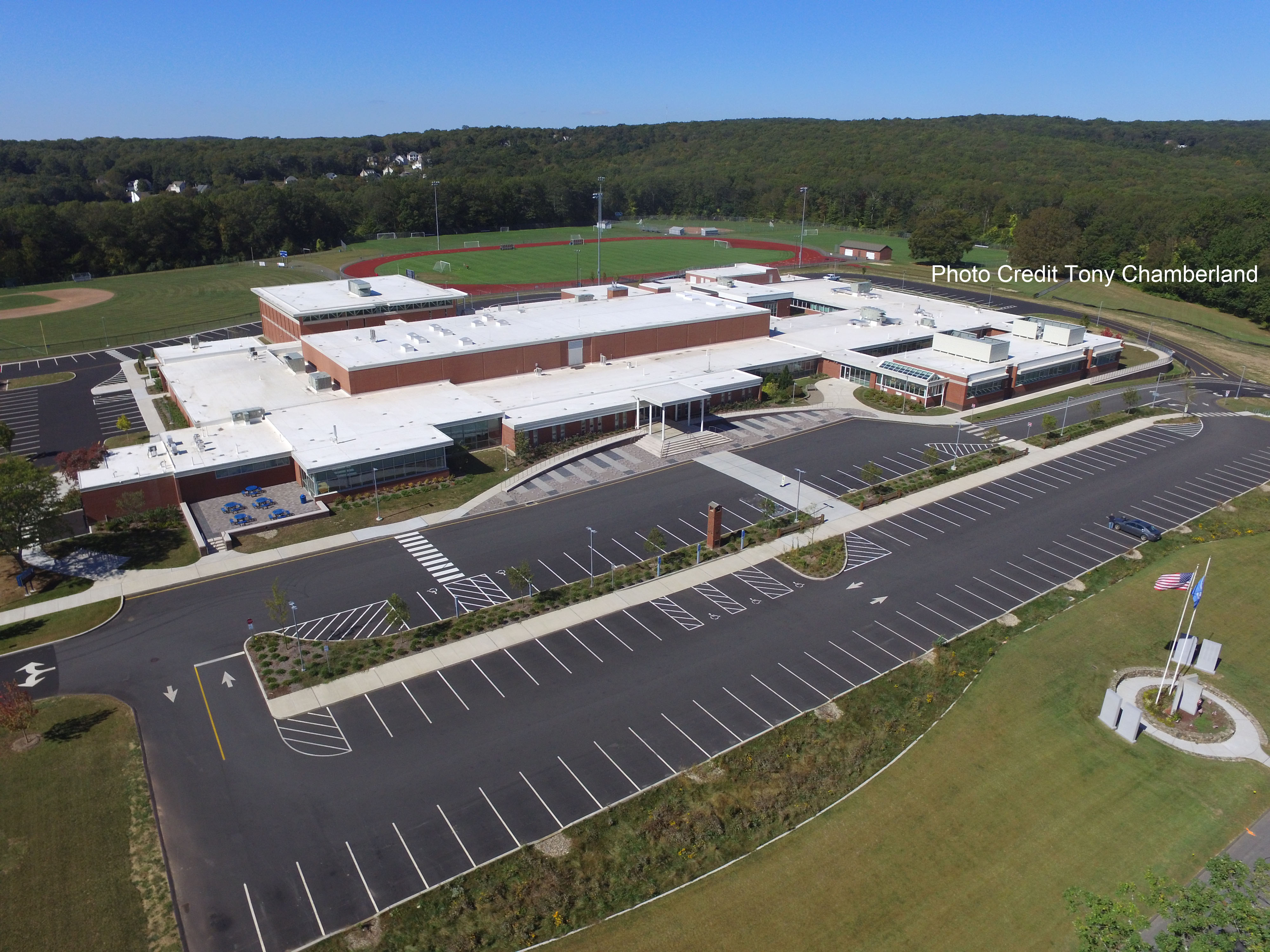 Aerial of East Hampton High School front parking lot, school and athletic fields